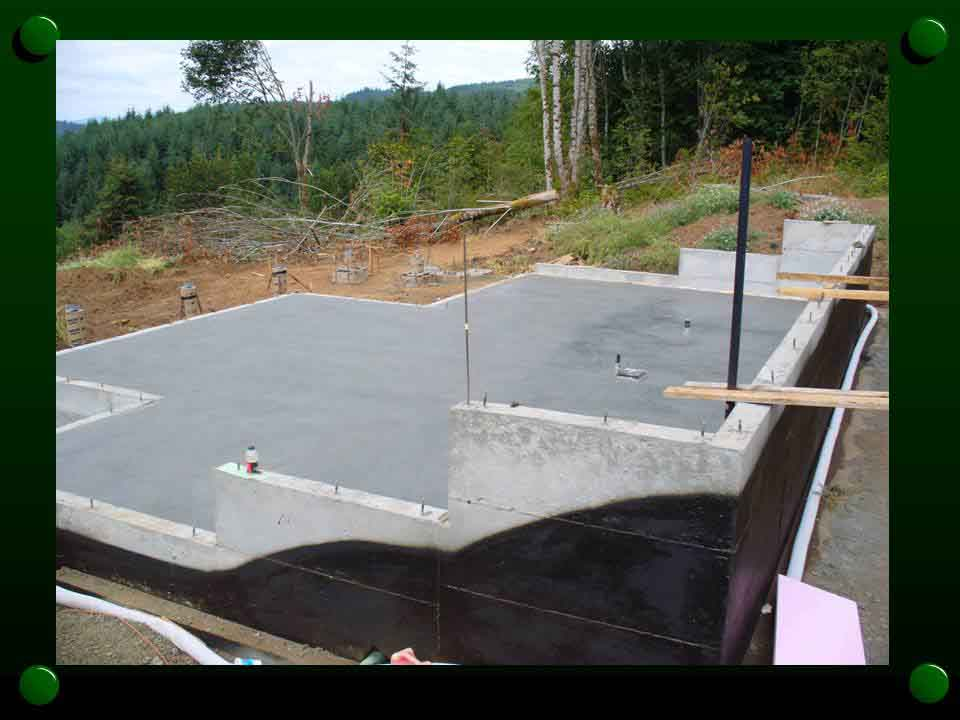 Custom concrete foundation with basment floor for large log cabin