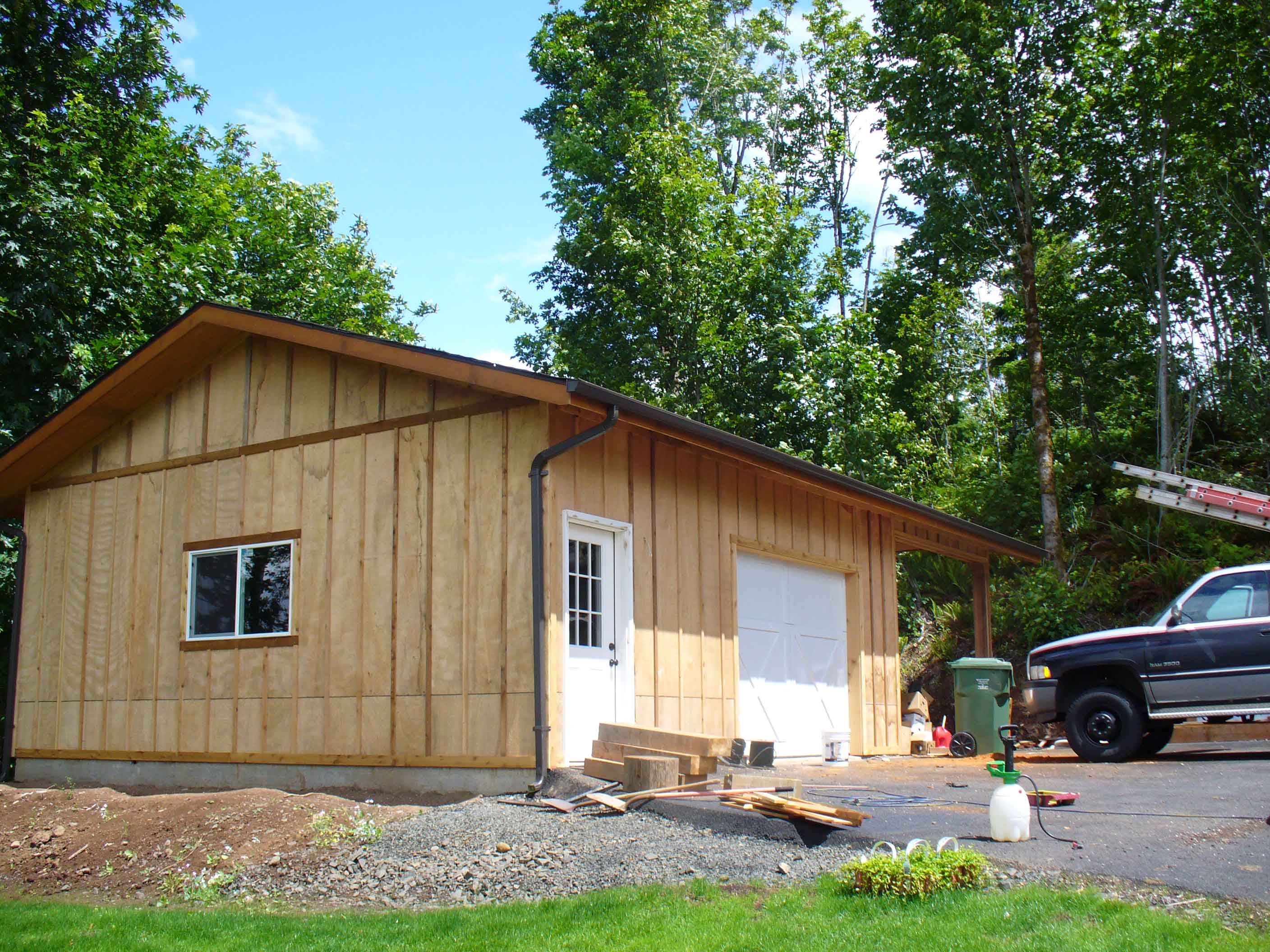 Garage with wood siding