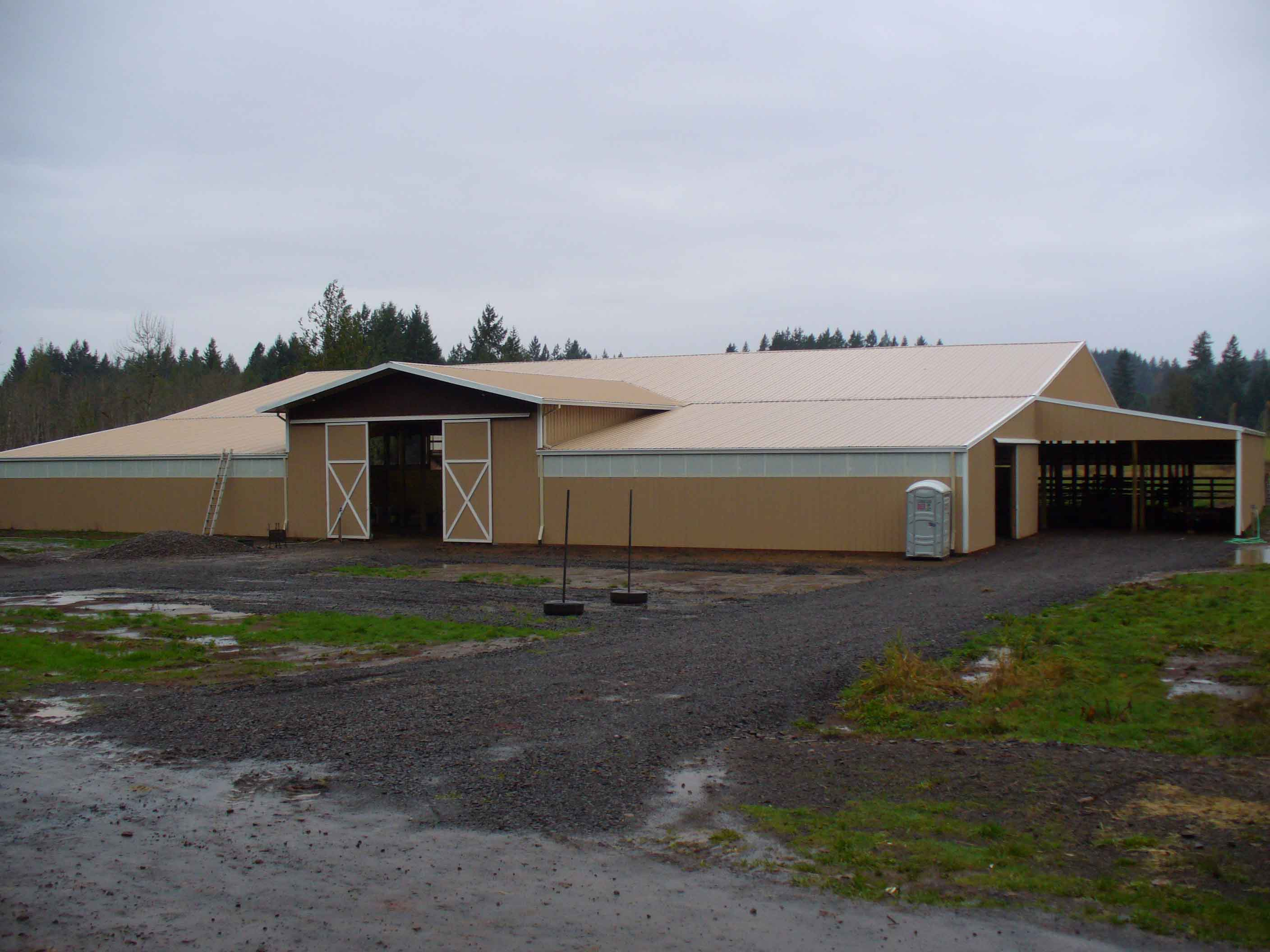 Large horse barn with custom slider doors