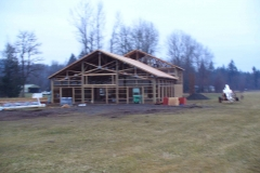 Framed pole building with 1200' living space and large meeting space on private airport