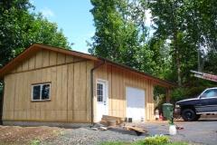 Garage with wood siding
