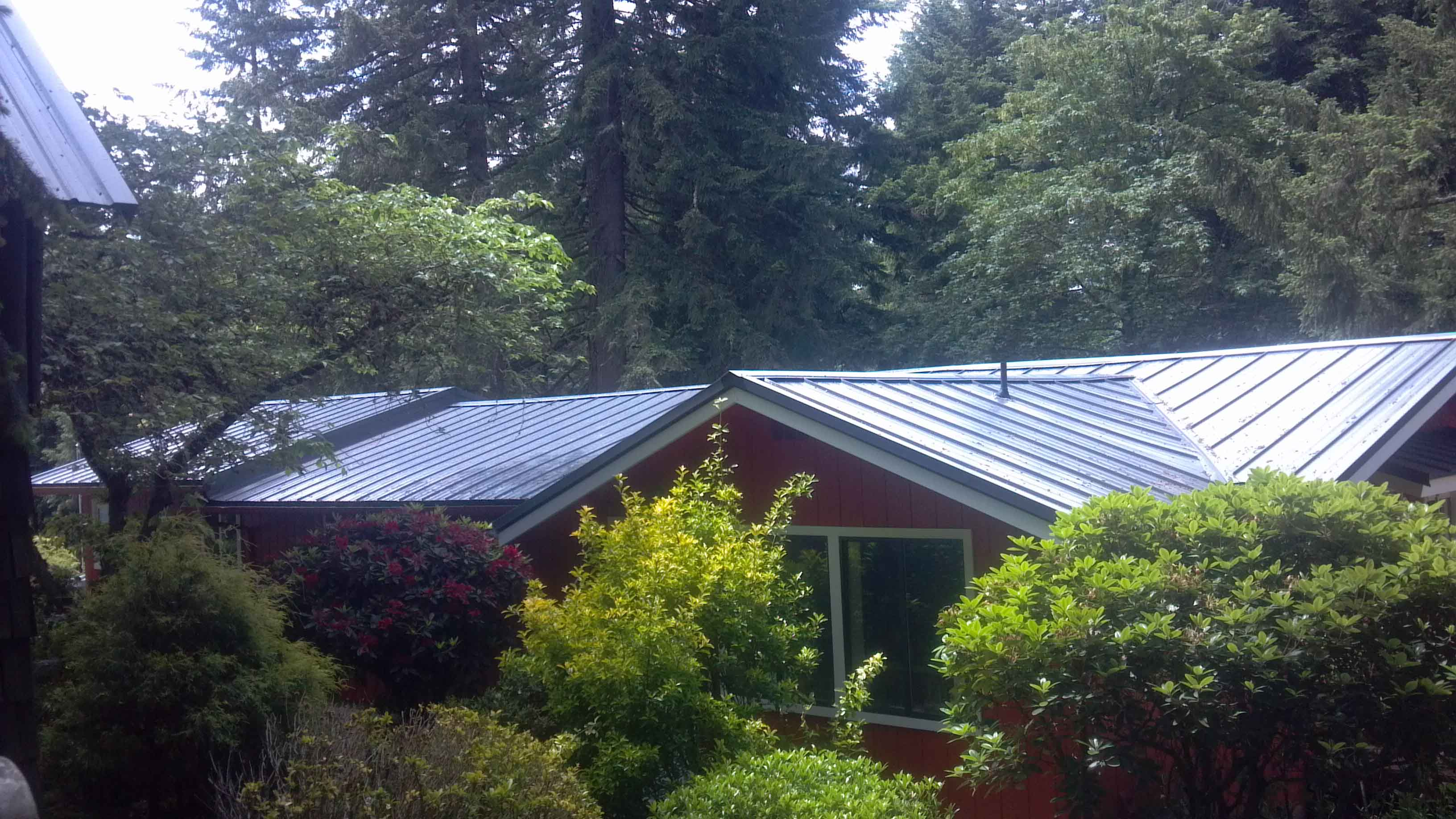 Loc-Seam metal roof installed over existing comp roof