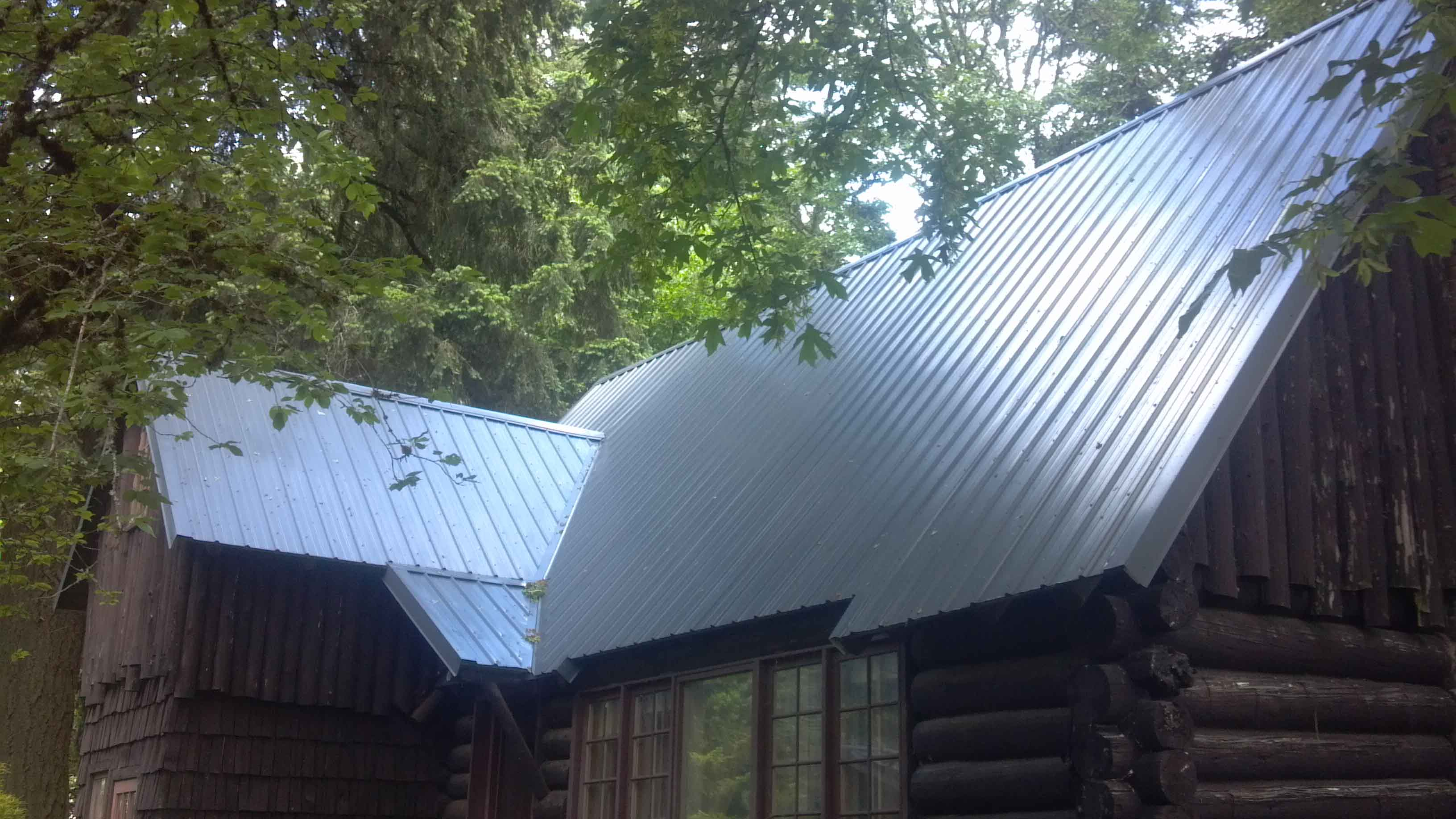 Metal roof on 90 year old log cabin