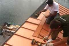 Installing Copper Penny Loc-Seam roof on house boat