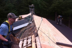 Installing new plywood on older home before new Loc-Seam roofing