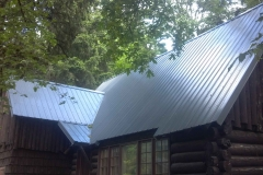 Magna-Rib metal roof on old log cabin